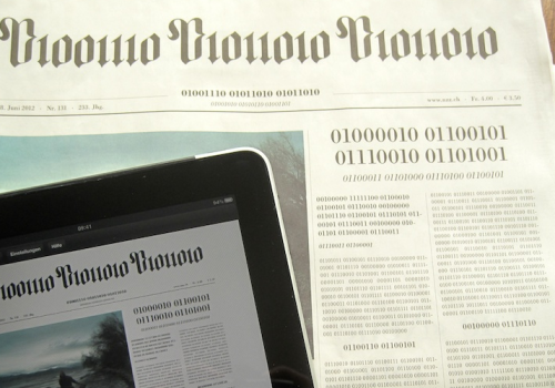 Swiss newspaper NZZ frontpage printed in binary code, human readable text on iPad (adapted) (Image by visualpun.ch [CC BY-SA 2.0] via Flickr)