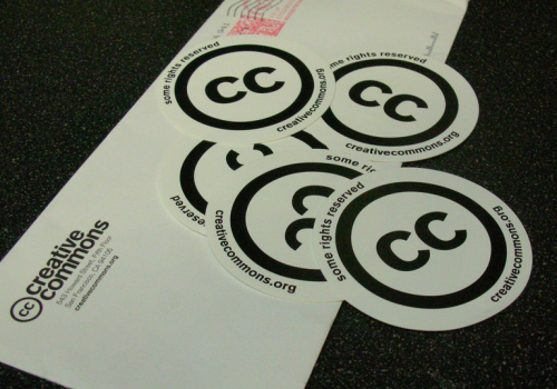 Creative Commons stickers (adapted) (Image by oswaldo [CC BY 2.0] via Flickr)