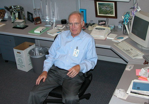Former Intel CEO Gordon Moore in his cubicle (adapted) (Image by Intel Free Press [CC BY-SA 2.0] via Flickr)