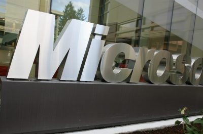 Microsoft sign outside building 99 (adapted) (Image by Robert Scoble [CC BY 2.0] via flickr)