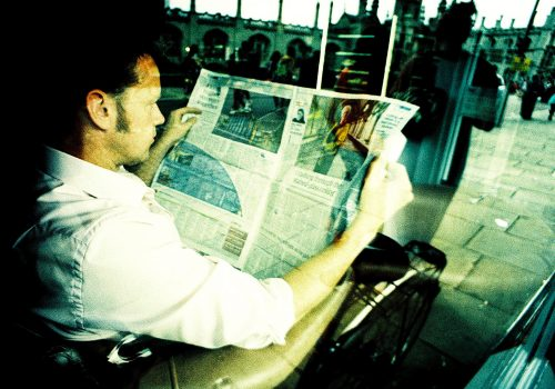 Reading the Newspaper (adapted) (Image by Nick Page [CC BY 2.0] via Flickr)