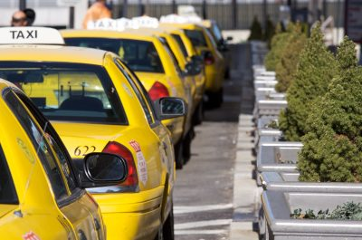 Taxi cabs at Penn Station (adapted) (Image by Marcin Wichary [CC BY 2.0] via Flickr)
