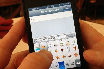 Texting Emoji (adapted) (Image by Intel Free Press [CC BY-SA 2.0] via Flickr)