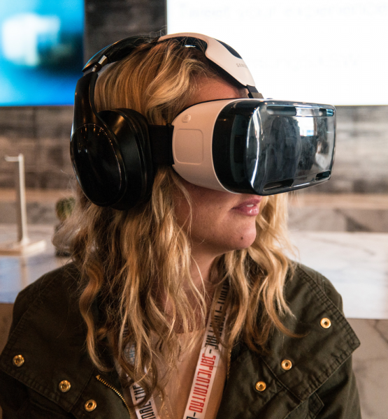 Woman Using a Samsung VR Headset at SXSW (adapted) (Image by Nan Palmero [CC BY 2.0] via Fickr)
