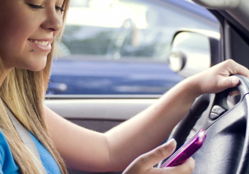 A teen girl texting while driving (Image by CDC/Amanda Mills [CC0 Public Domain], via Freestockphotos.biz)