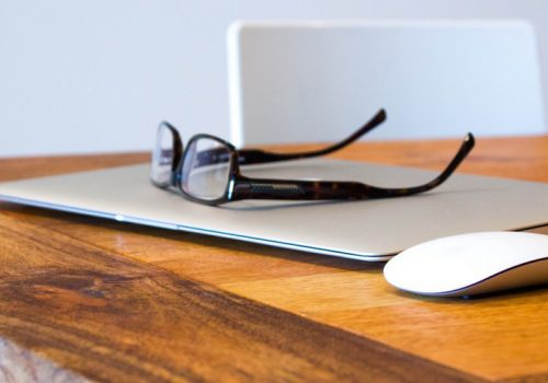 Still Life of Glasses on MacBook Air with Mouse (adapted) (Image by Image Catalog [CC0 Public Domain] via Flickr)