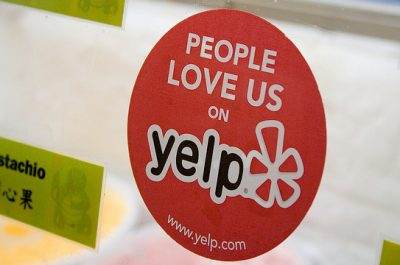 Yelp Sticker and Reviews (adapted) (Image by StickerGiant Custom Stickers [CC BY 2.0] via Flickr)