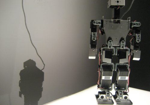 robot and shadow (adapted) (Image by Hsing Wei [CC BY 2.0] via Flickr)