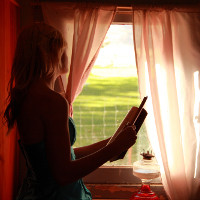 Girl Holding Book Looking Out Window free creative commons (Image by D Sharon Pruitt [CC BY 2.0] via Flickr)