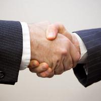 Handshake - 2 men (Image by Flazingo Photos [CC BY-SA 2.0] via Flickr)
