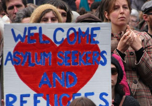 Welcome asylum seekers and refugees - Refugee Action protest 27 July 2013 Melbourne (adapted) (Image by Takver [CC BY-SA 2.0] via Flickr)