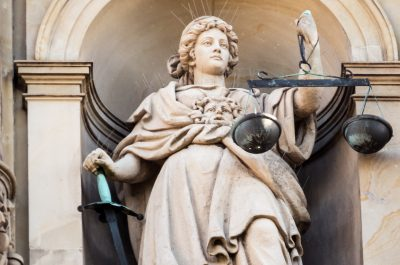Justitia (adapted) (Image by Markus Daams [CC BY 2.0] via flickr)