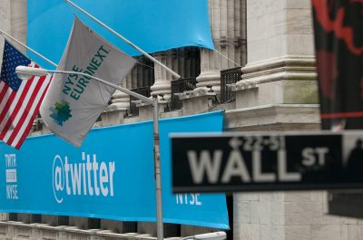 A Twitter Banner Draped Over The New York Stock Exchange For Twitter's IPO (adapted) (Image by Anthony Quintano [CC BY 2.0] via flickr)