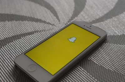 Snapchat (adapted) (Image by AdamPrzezdziek [CC BY-SA 2.0] via Flickr)