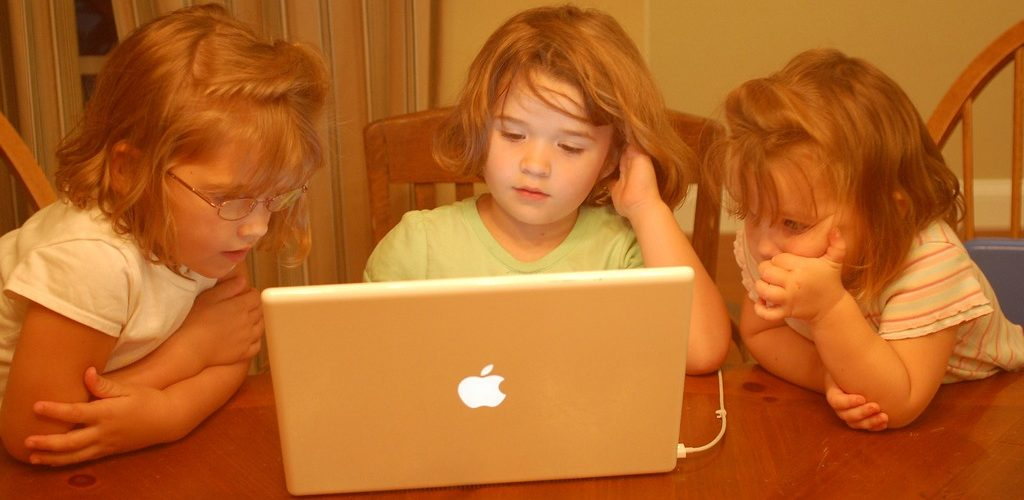Hersman Girls - Already on Computers... (adapted) (Image by Erik (HASH) Hersman [CC BY 2.0] via flickr)