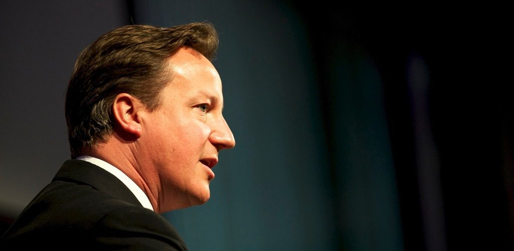 Prime Minister David Cameron, speaking at the opening of the GAVI Alliance immunisations pledging conference (adapted) (Image by DFID - UK Department of International Development [CC BY 2.0] via Flickr)