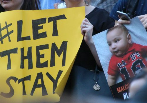 Yellow sign - Sanctuary rally #LetThemStay Melbourne (adapted) (Image by Takver [CC BY-SA 2.0] via flickr)