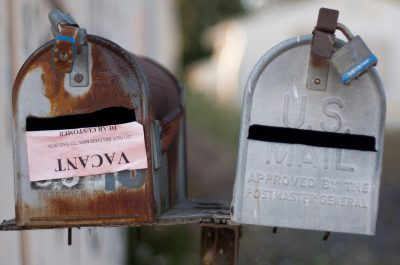 Rusted Mailboxes (adapted) (Image by aaron nunez [CC BY 2.0] via Flickr)
