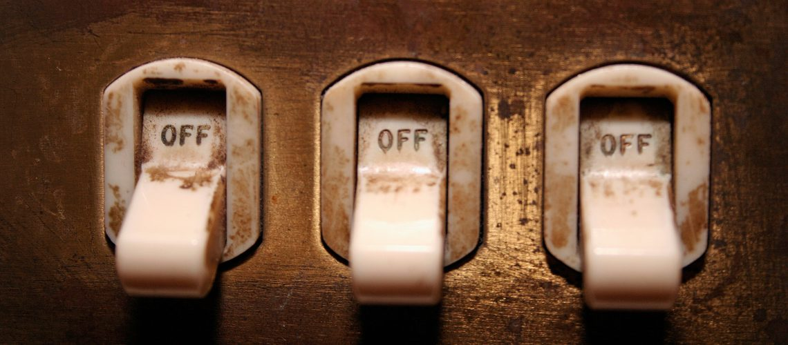 Old Light Switches (adapted) (Image by Paul Cross [CC BY 2.0] via Flickr)