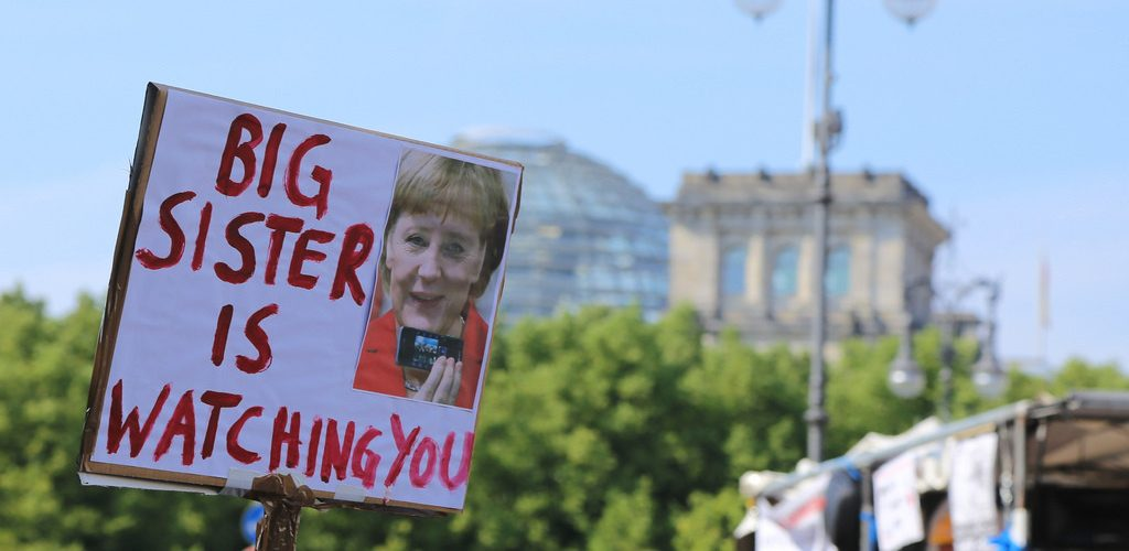 Big Sister is Watching You - Stop Watching Us, Berlin, 27.07.2013 (adapted) (Image by mw238 [CC BY-SA 2.0] via Flickr)