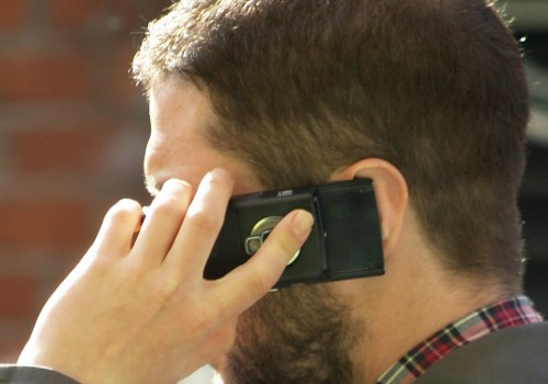 Man_speaking_on_mobile_phone (Image by Tim Parkinson [CC by 2.0] wikipedia commons
