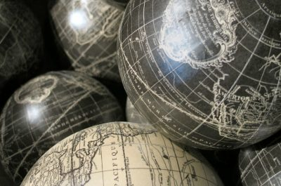 Globes (adapted) (Image by Jayel Aheram [CC BY 2.0] via flickr)