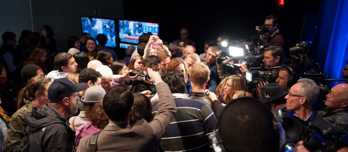 Media Scrum (adpted) (Image by Olivia Chow [CC BY 2.0] via Flickr)