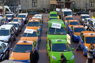 Taxi Cabs vs Uber (adapted) (Image by Aaron Parecki [CC BY 20] via Flickr)