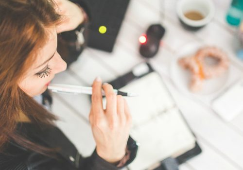 Young woman thinking with pen while working (Image by Karolina Grabowska [CC0 Public Domain] via Pexels)