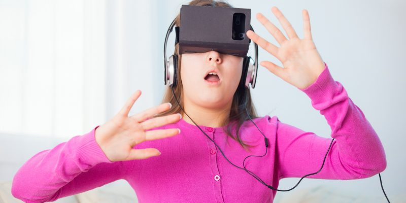 Girl Playing Video Game With Virtual Reality Headset