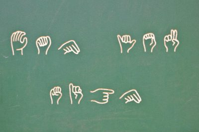 Learn sign language at the playground (adapted) (Image by Valerie Everett [CC BY-SA 2.0] via Flickr)