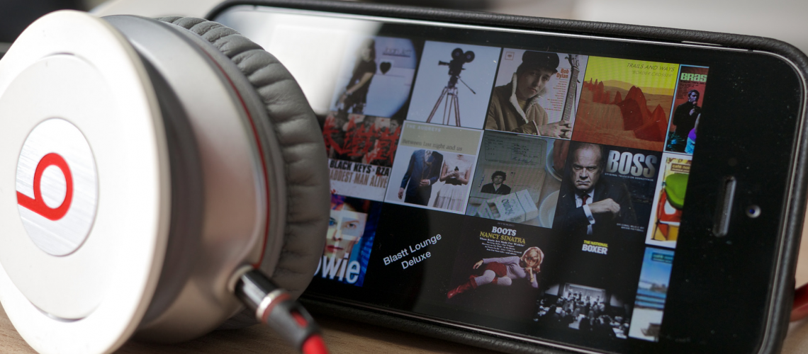 Apple & Beats (adapted) (Image by Kārlis Dambrāns [CC BY 2.0] via Flickr)