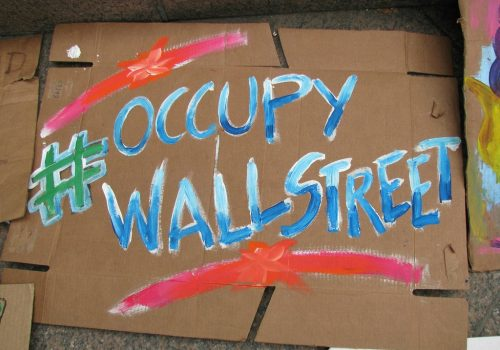 Occupy Wall Street (adapted) (Image by Eden, Janine and Jim [CC BY 2.0] via flickr)