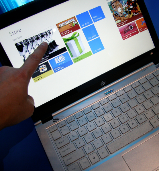 Online Shopping with Touchscreen Ultrabook (adapted) (Image by Intel Free Press [CC BY 2.0] via Flickr)