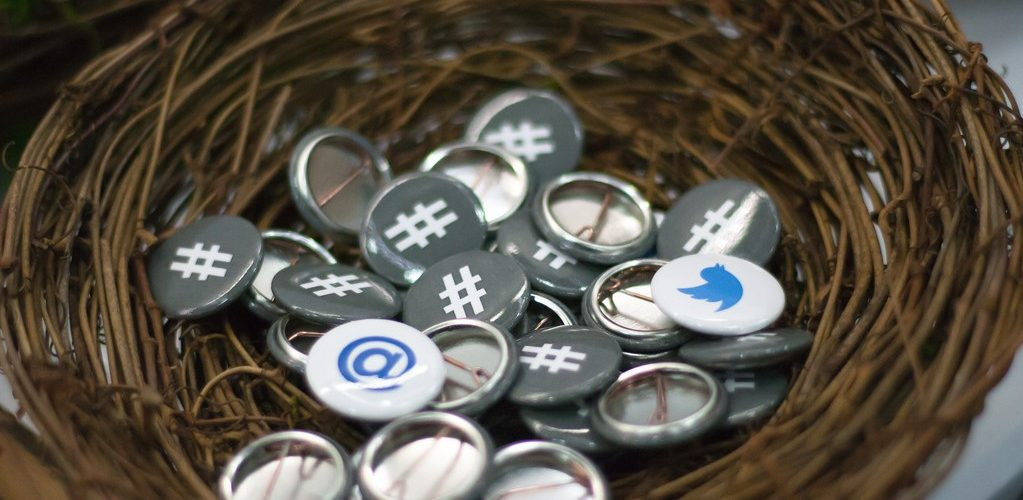 Twitter Buttons at OSCON adapted) (Image by Garrett Heath [8CC BY 2.0], via flickr)