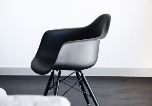 "Image (adapted) ""Black Eames Style Chair"" by andres daniel jasso (CC0) by unsplash)"
