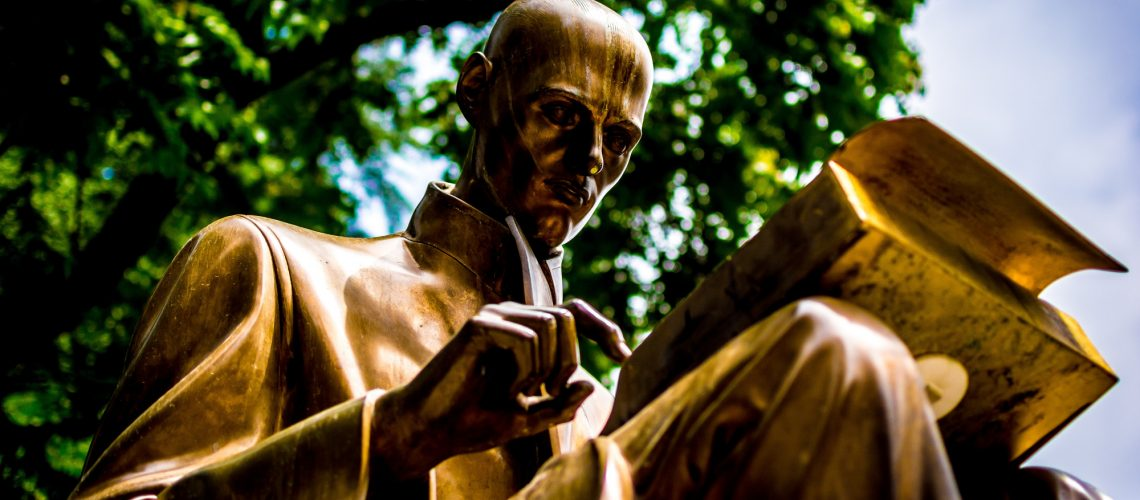 Statue of man reading (adapted) (Image by Carl Cerstrand [CC0 Public Domain] via Unsplash)