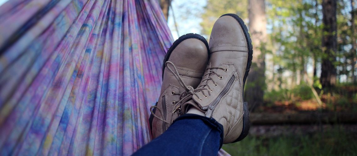 Hammrock, relax, person and boot (adapted) (Image by Nicole Harrington [CC0 Public Domain] via Unsplash)