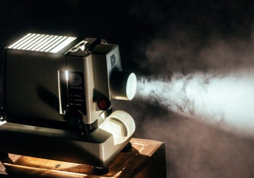 Light, projector, mist and retro HD (adapted) (Image by Jeremy Yap [CC0 Public Domain] via Unsplash)