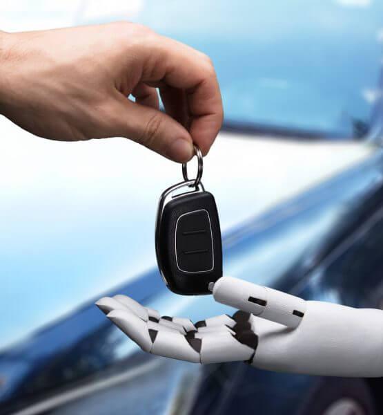 Ein mensch gibt einem Roboter den Autoschlüssel