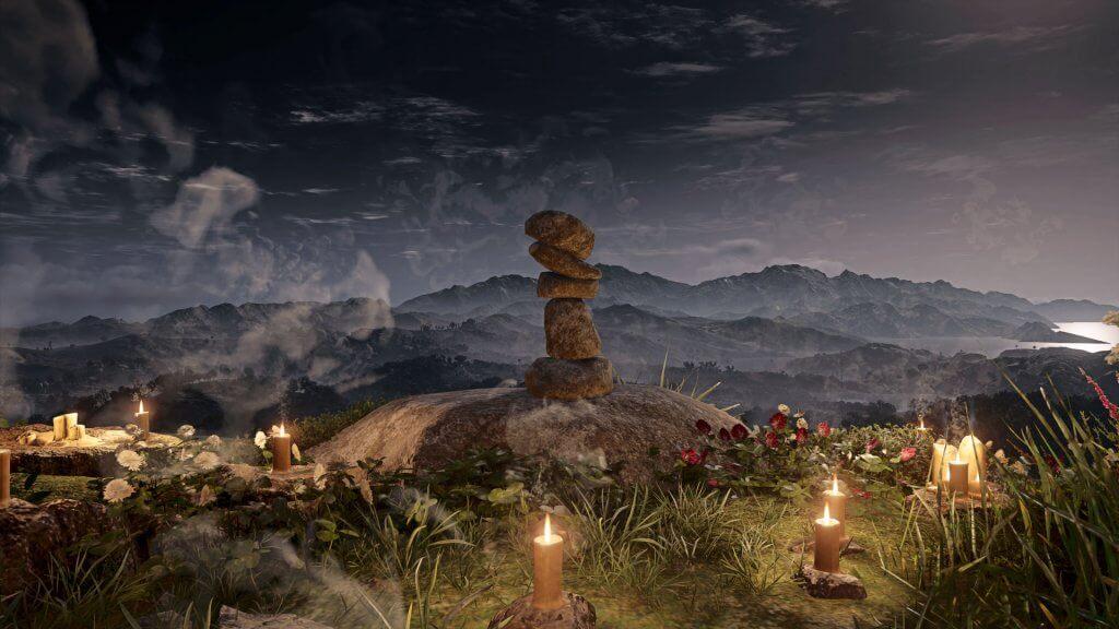 Kunstvoll gestapelte Steine in Assassins Creed Valhalla, beleuchtet von Kerzen